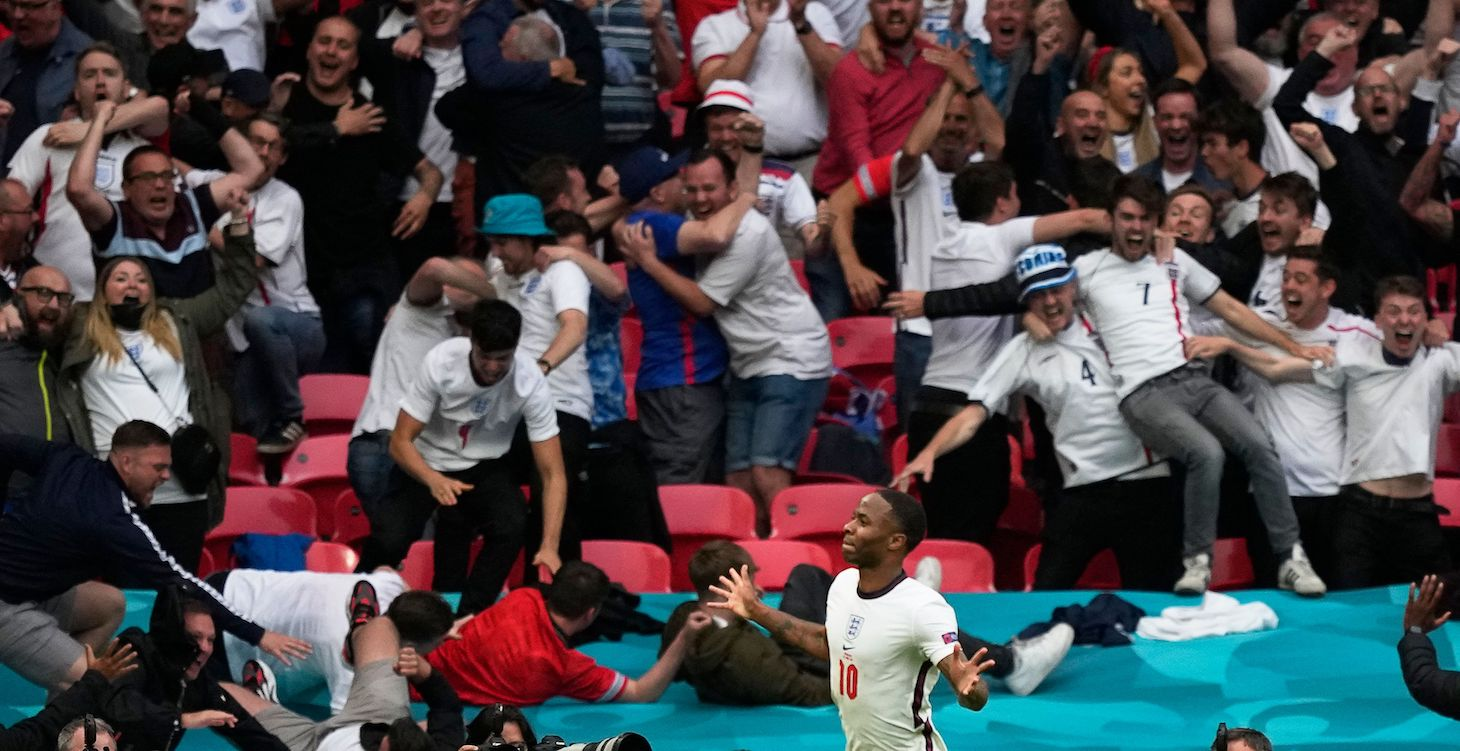 England's forward Raheem Sterling (L) celebrates after scoring the opening goal during the UEFA EURO 2020 round of 16 football match between England and Germany at Wembley Stadium in London on June 29, 2021.