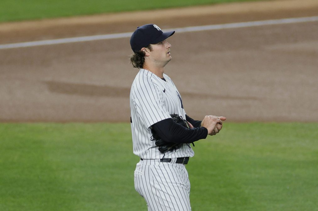 Gerrit Cole of the Yankees rubs up a baseball, with what we can presume is nothing at all, just a normal thing you do with your hands.