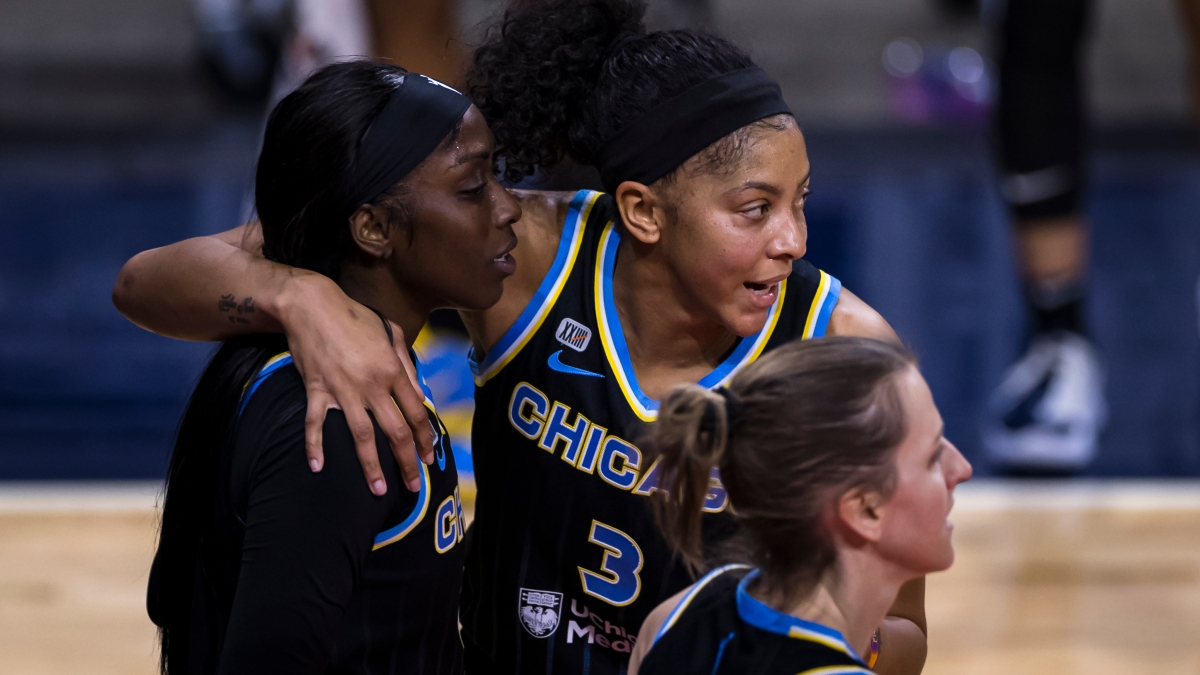 Candace Parker #3 of the Chicago Sky huddles with teammates Kahleah Copper #2 and Allie Quigley #14 during the first half of the game against the Washington Mystics at Entertainment & Sports Arena on May 15, 2021 in Washington, DC.
