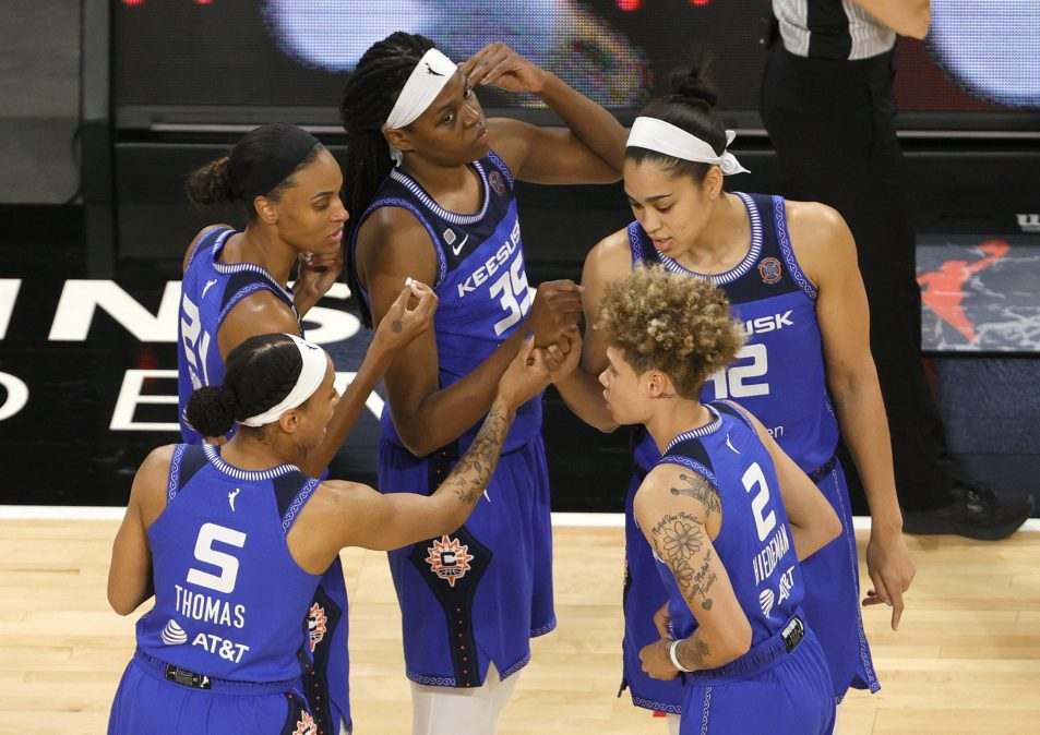 Jasmine Thomas #5, DeWanna Bonner #24, Jonquel Jones #35, Natisha Hiedeman #2 and Brionna Jones #42 of the Connecticut Sun huddle on the court before their game against the Las Vegas Aces at Michelob ULTRA Arena on May 23, 2021 in Las Vegas, Nevada. The Sun defeated the Aces 72-65.