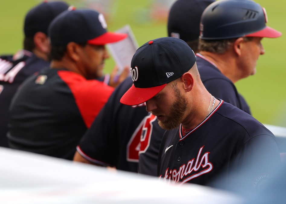Stephen Strasburg looks bummed as he leaves the field following another injury.