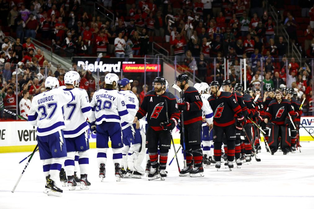 the Lightning shake hands with the Hurricanes