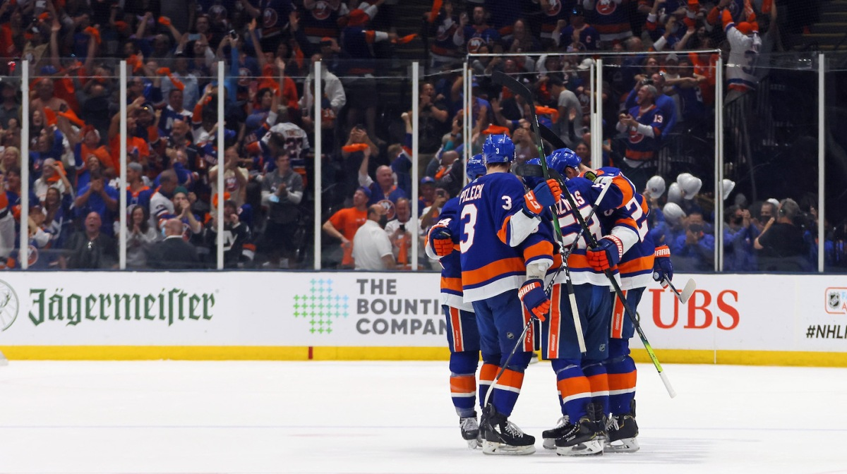 UNIONDALE, NEW YORK - JUNE 09: The New York Islanders celebrate an empty net goal by Cal Clutterbuck #15 of the New York Islanders against the Boston Bruins in Game Six of the Second Round of the 2021 NHL Stanley Cup Playoffs at the Nassau Coliseum on June 09, 2021 in Uniondale, New York. The Islanders defeated the Bruins 6-2 to move on to the Stanley Cup Semifinals against the Tampa Bay Lightning. (Photo by Bruce Bennett/Getty Images)