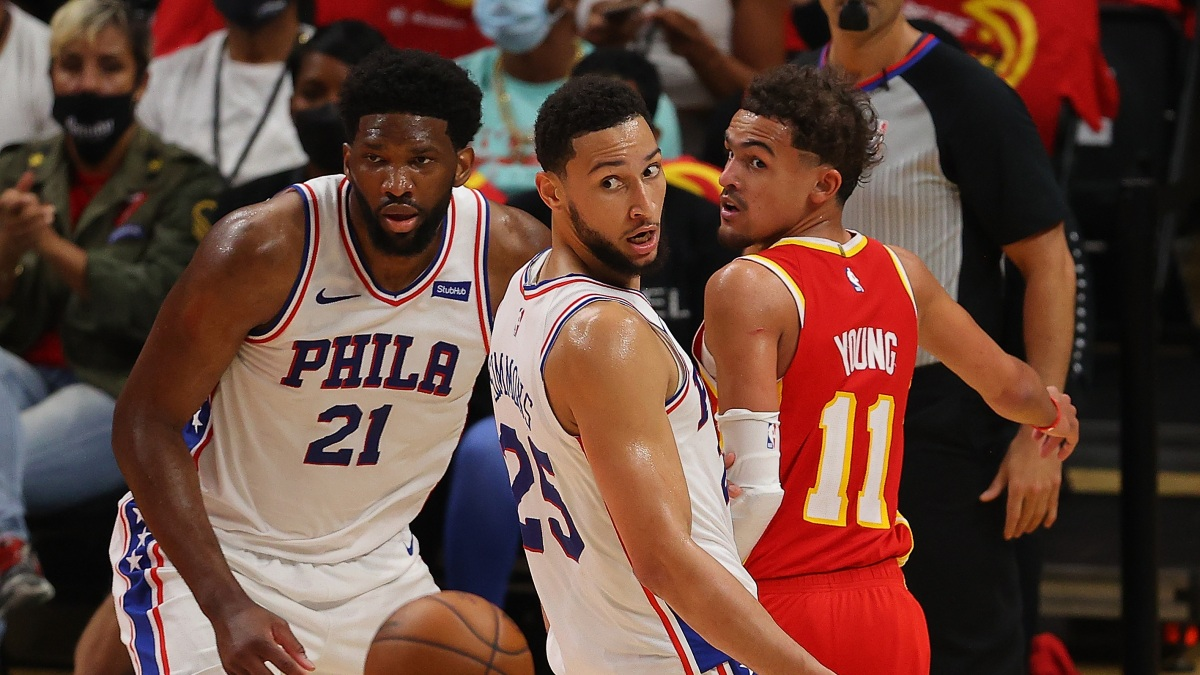 Joel Embiid, Ben Simmons, and Trae Young watch the ball.