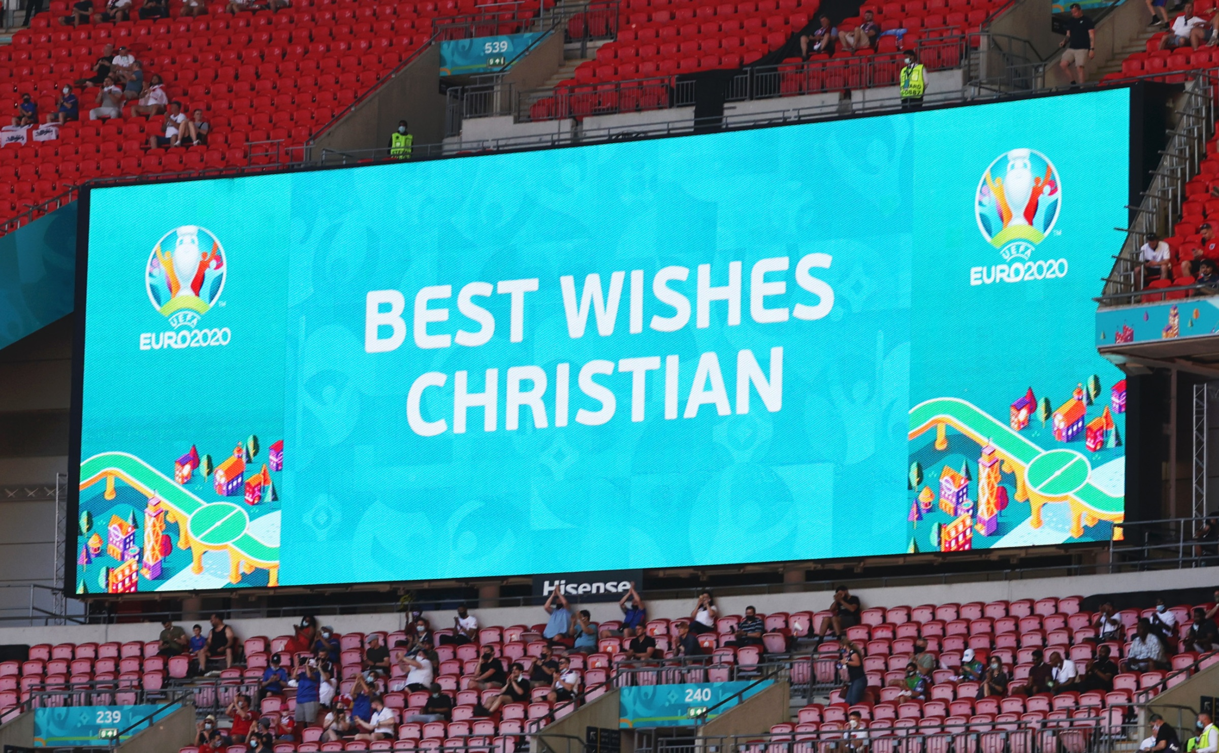 A stadiums screen shows shows a message of support for Christian Eriksen