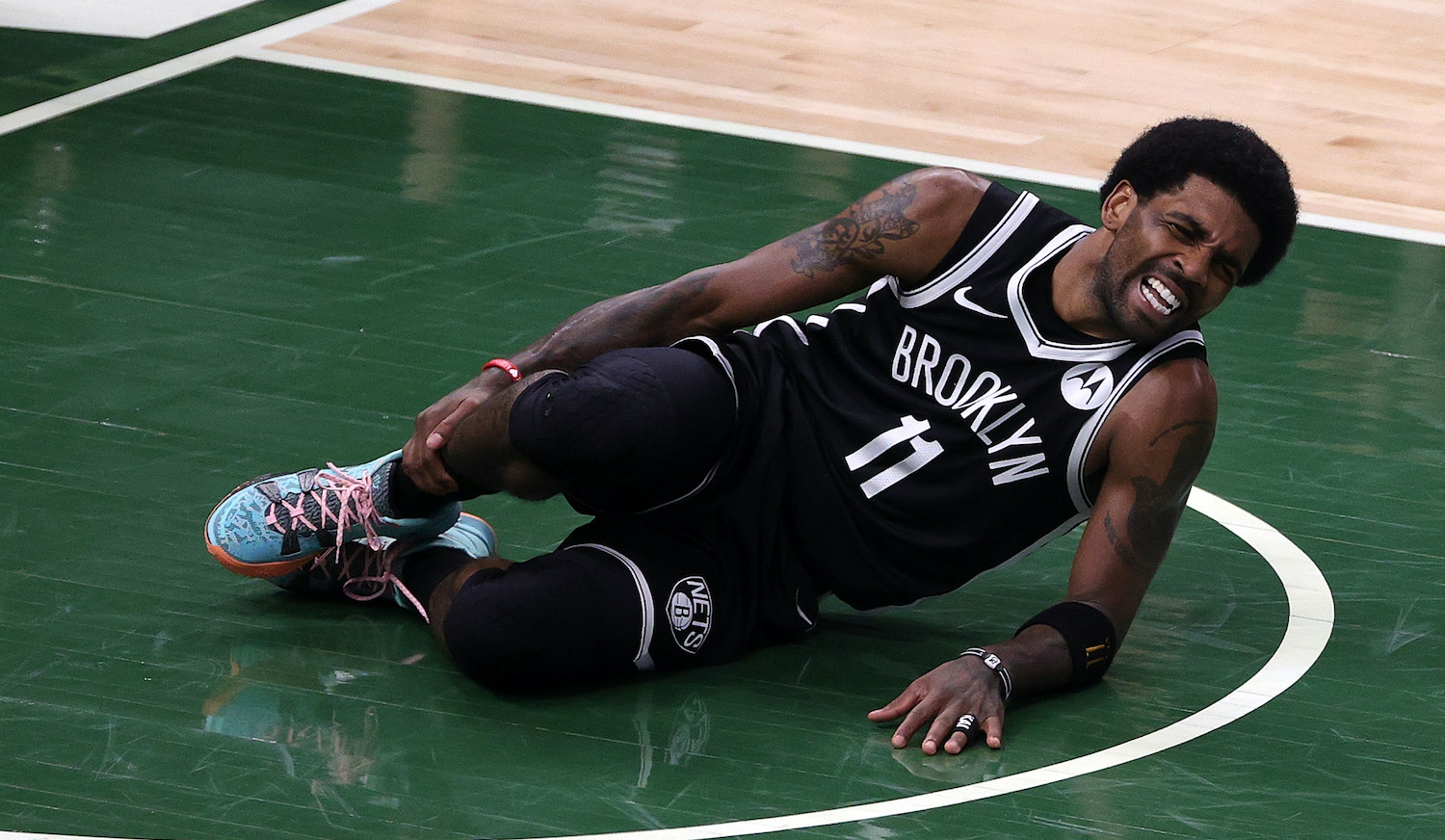 MILWAUKEE, WISCONSIN - JUNE 13: Kyrie Irving #11 of the Brooklyn Nets is injured during the first half of Game Four of the Eastern Conference second round playoff series against the Milwaukee Bucks at the Fiserv Forum on June 13, 2021 in Milwaukee, Wisconsin. NOTE TO USER: User expressly acknowledges and agrees that, by downloading and or using this photograph, User is consenting to the terms and conditions of the Getty Images License Agreement. (Photo by Stacy Revere/Getty Images)