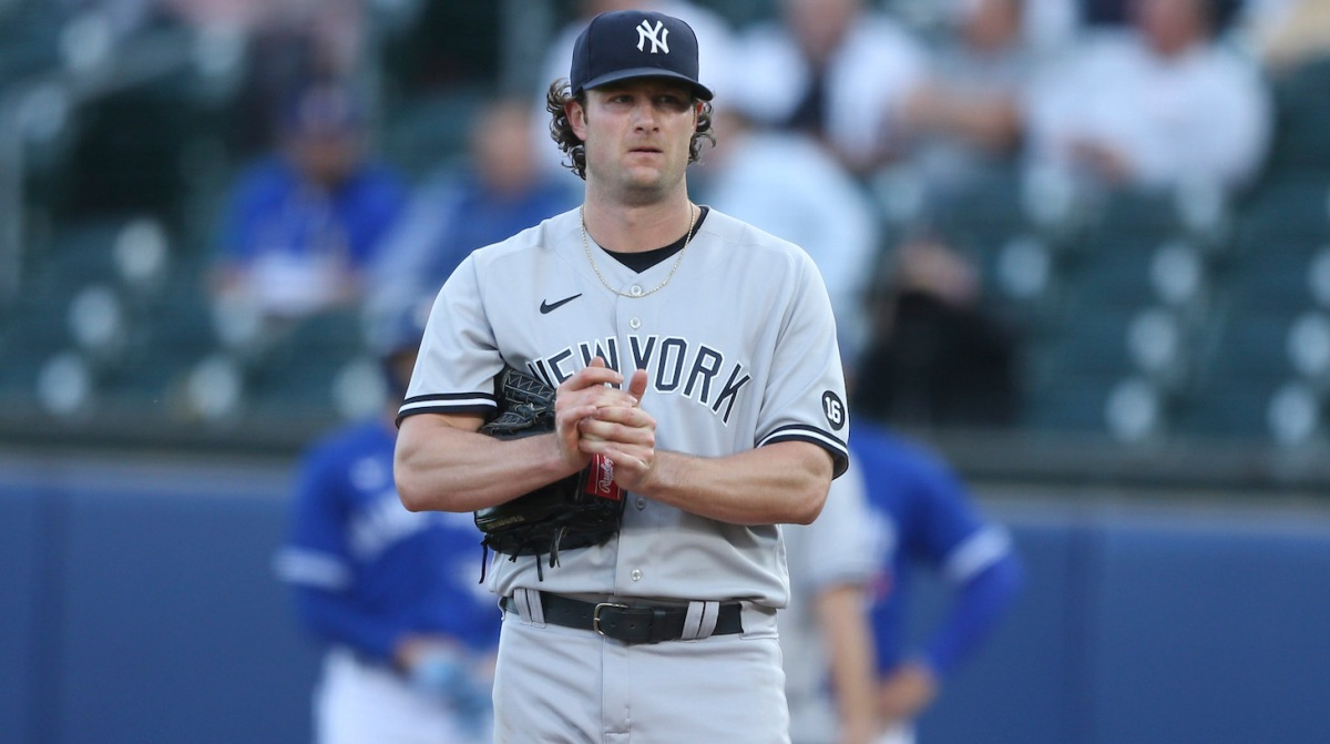 BUFFALO, NEW YORK - JUNE 16: Gerrit Cole #45 of the New York Yankees rubs the ball between pitches during the second inning against the Toronto Blue Jays at Sahlen Field on June 16, 2021 in Buffalo, New York. (Photo by Joshua Bessex/Getty Images)