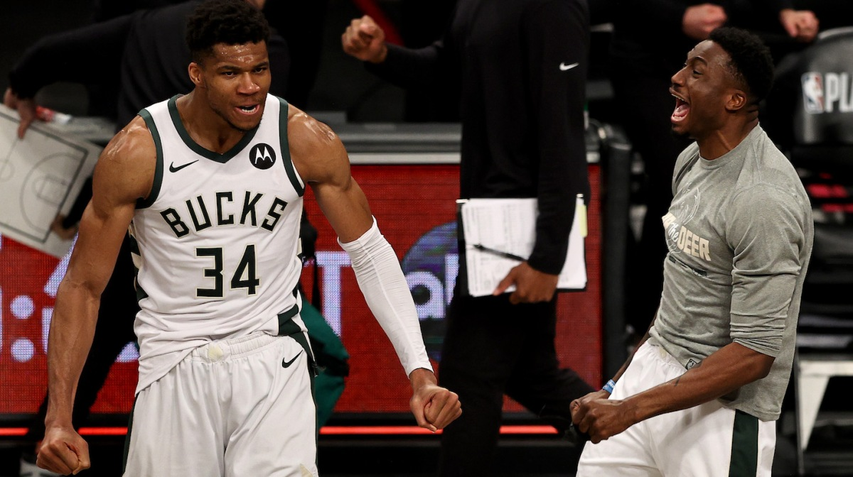 Giannis Antetokounmpo #34 and Thanasis Antetokounmpo #43 of the Milwaukee Bucks celebrate the win of game seven of the Eastern Conference second round at Barclays Center on June 19, 2021 in the Brooklyn borough of New York City. The Milwaukee Bucks defeated the Brooklyn Nets 115-111 in overtime to win the series.