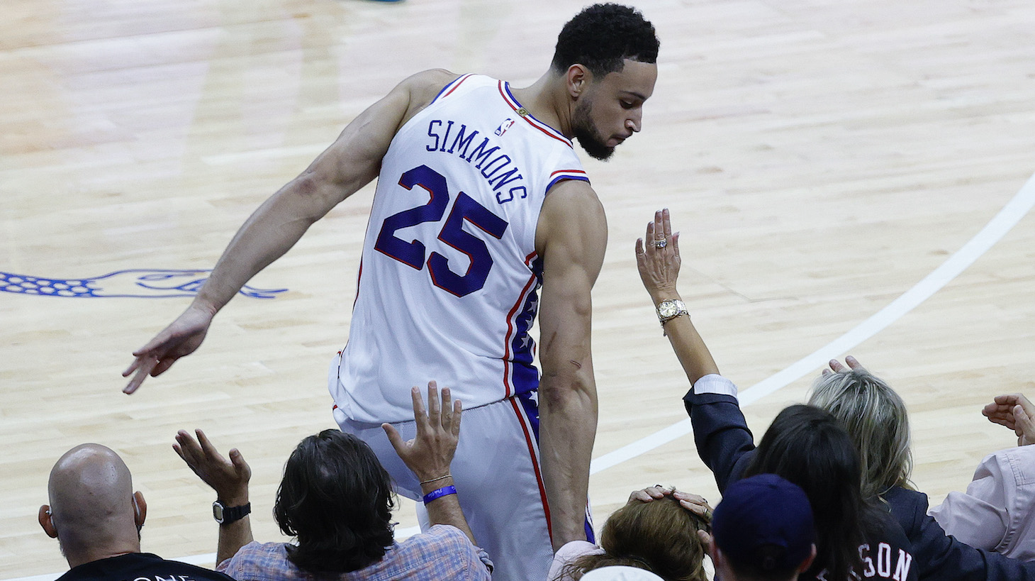 PHILADELPHIA, PENNSYLVANIA - JUNE 20: Ben Simmons #25 of the Philadelphia 76ers bumps into fans during the fourth quarter during Game Seven of the Eastern Conference Semifinals against the Atlanta Hawks at Wells Fargo Center on June 20, 2021 in Philadelphia, Pennsylvania. NOTE TO USER: User expressly acknowledges and agrees that, by downloading and or using this photograph, User is consenting to the terms and conditions of the Getty Images License Agreement. (Photo by Tim Nwachukwu/Getty Images)