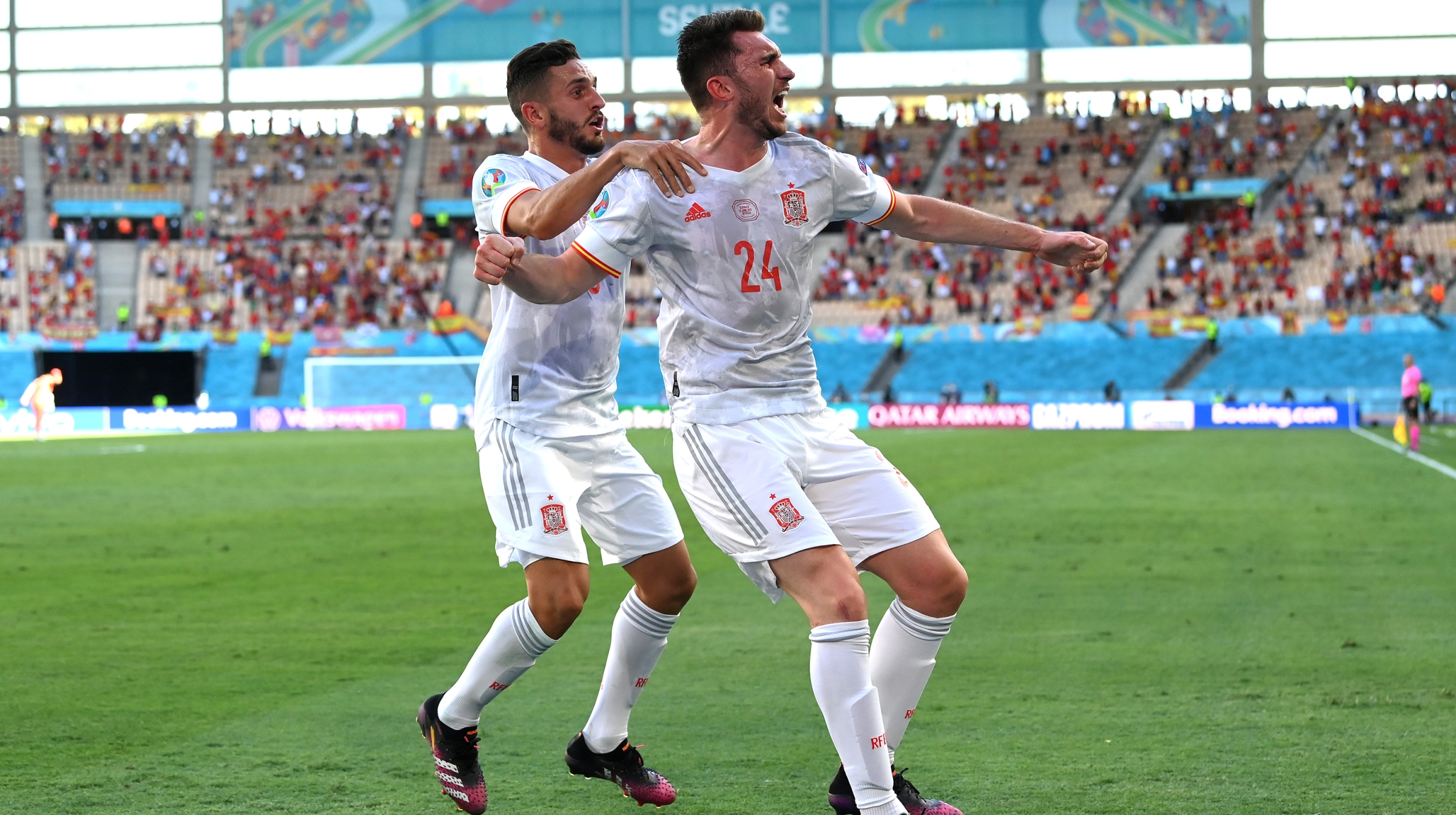 Aymeric Laporte of Spain celebrates with Koke after scoring their side's second goal during the UEFA Euro 2020 Championship Group E match between Slovakia and Spain at Estadio La Cartuja on June 23, 2021 in Seville, Spain.