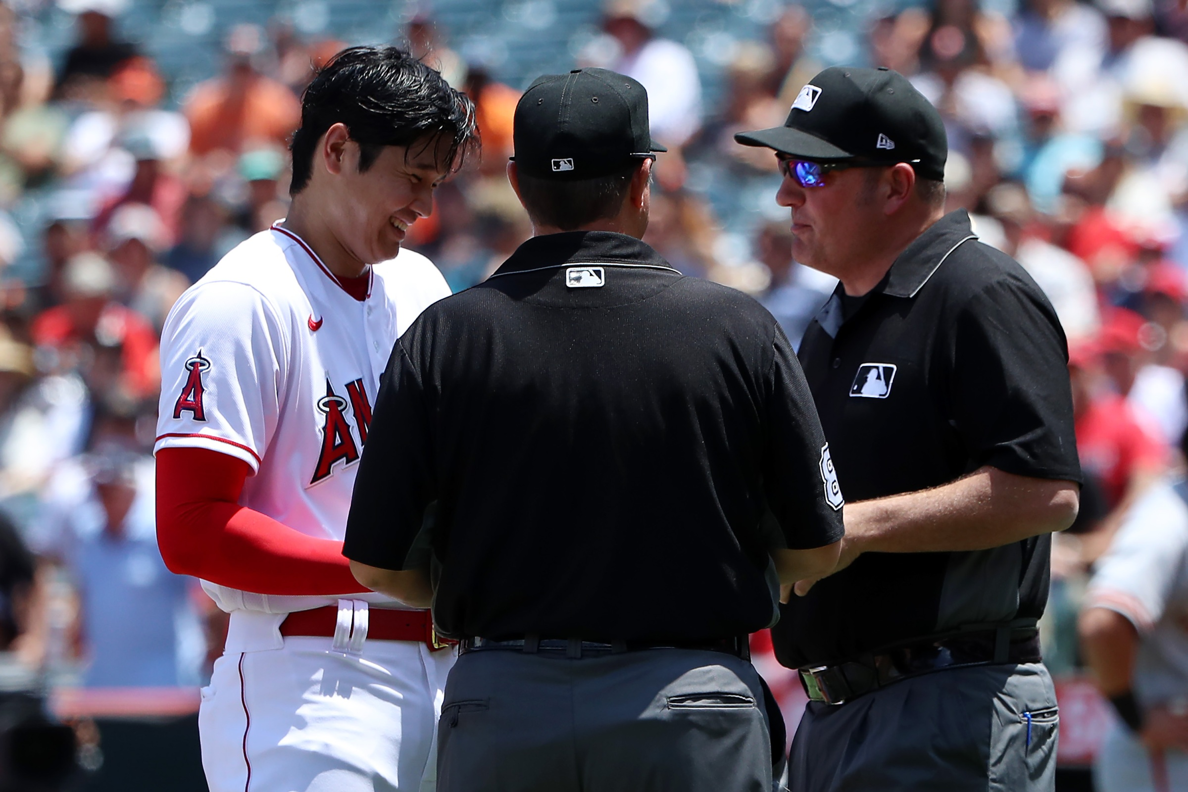 Shohei Ohtani chuckles good-naturedly through a search for sticky stuff.