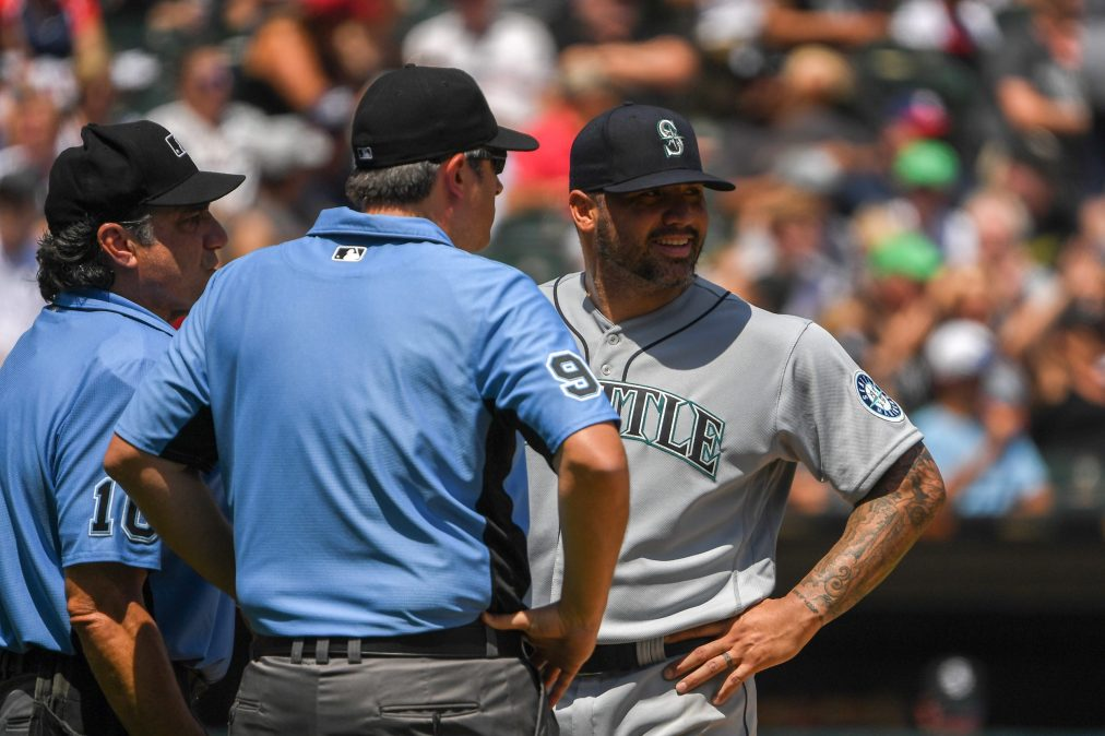 Hector Santiago of the Mariners gets ejected by umpires for having slime inside his glove.