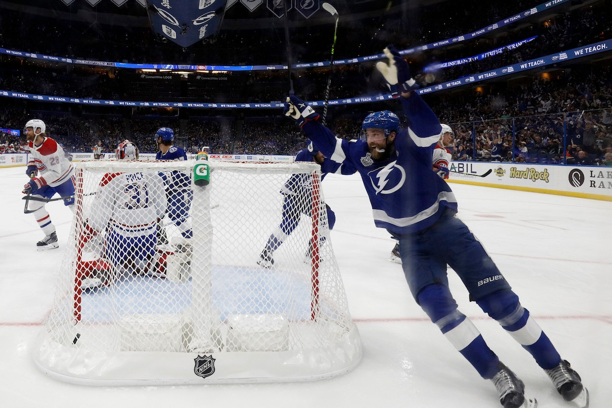 TAMPA, FLORIDA - JUNE 28: Victor Hedman #77 of the Tampa Bay Lightning celebrates a goal by Yanni Gourde past Carey Price #31 of the Montreal Canadiens during the third period in Game One of the 2021 NHL Stanley Cup Final at Amalie Arena on June 28, 2021 in Tampa, Florida. (Photo by Mike Carlson/Getty Images)