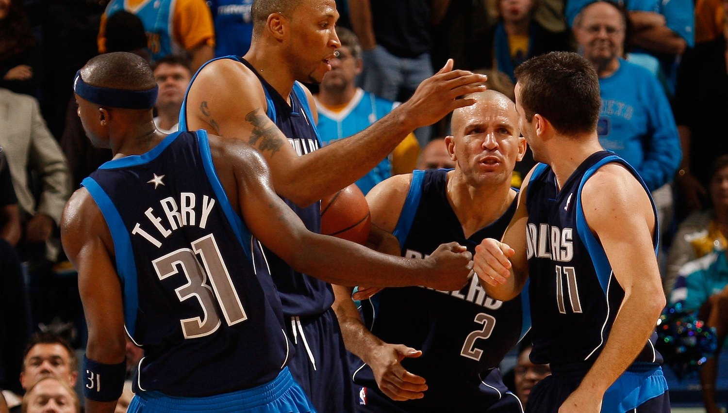 NEW ORLEANS - NOVEMBER 04: Jason Terry #31, Shawn Marion #0, Jason Kidd #2 congratulate Jose Barea #11 of the Dallas Mavericks during the game against the New Orleans Hornets at New Orleans Arena on November 4, 2009 in New Orleans, Louisiana. NOTE TO USER: User expressly acknowledges and agrees that, by downloading and or using this photograph, User is consenting to the terms and conditions of the Getty Images License Agreement. (Photo by Chris Graythen/Getty Images)
