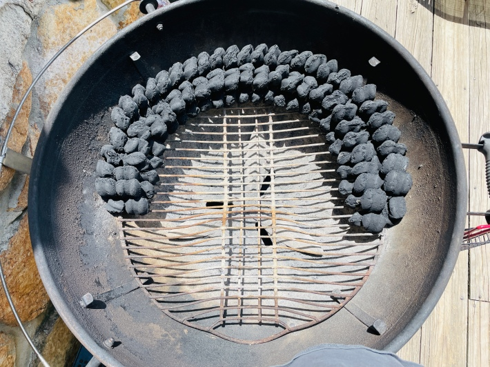A two-layer double row of charcoal, around the inside edge of a charcoal kettle grill.