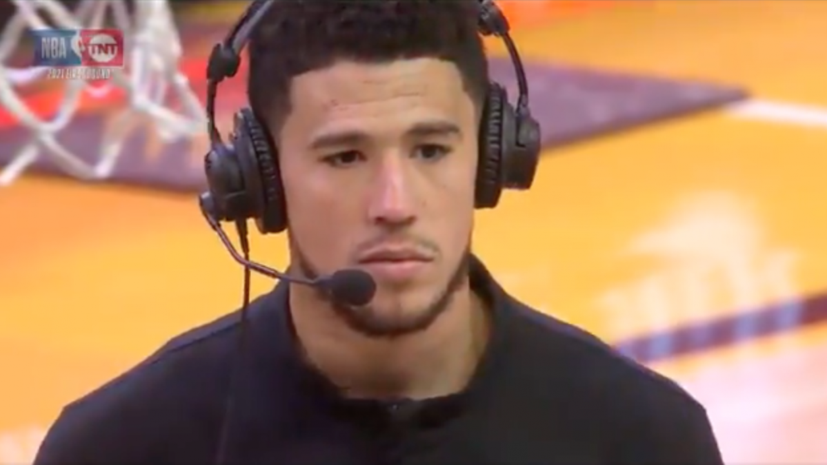 Devin Booker looks at Chris Haynes as Haynes asks his insanely stupid question.