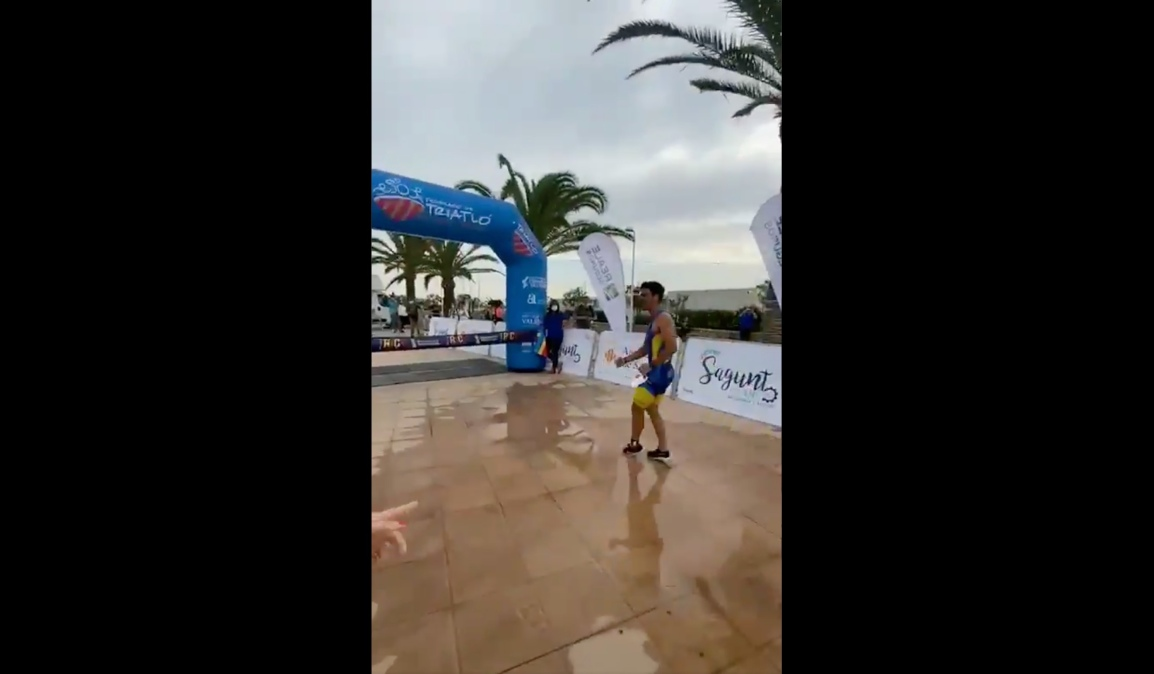 Image of trathlete mere feet from the finish line, moments before getting beat.