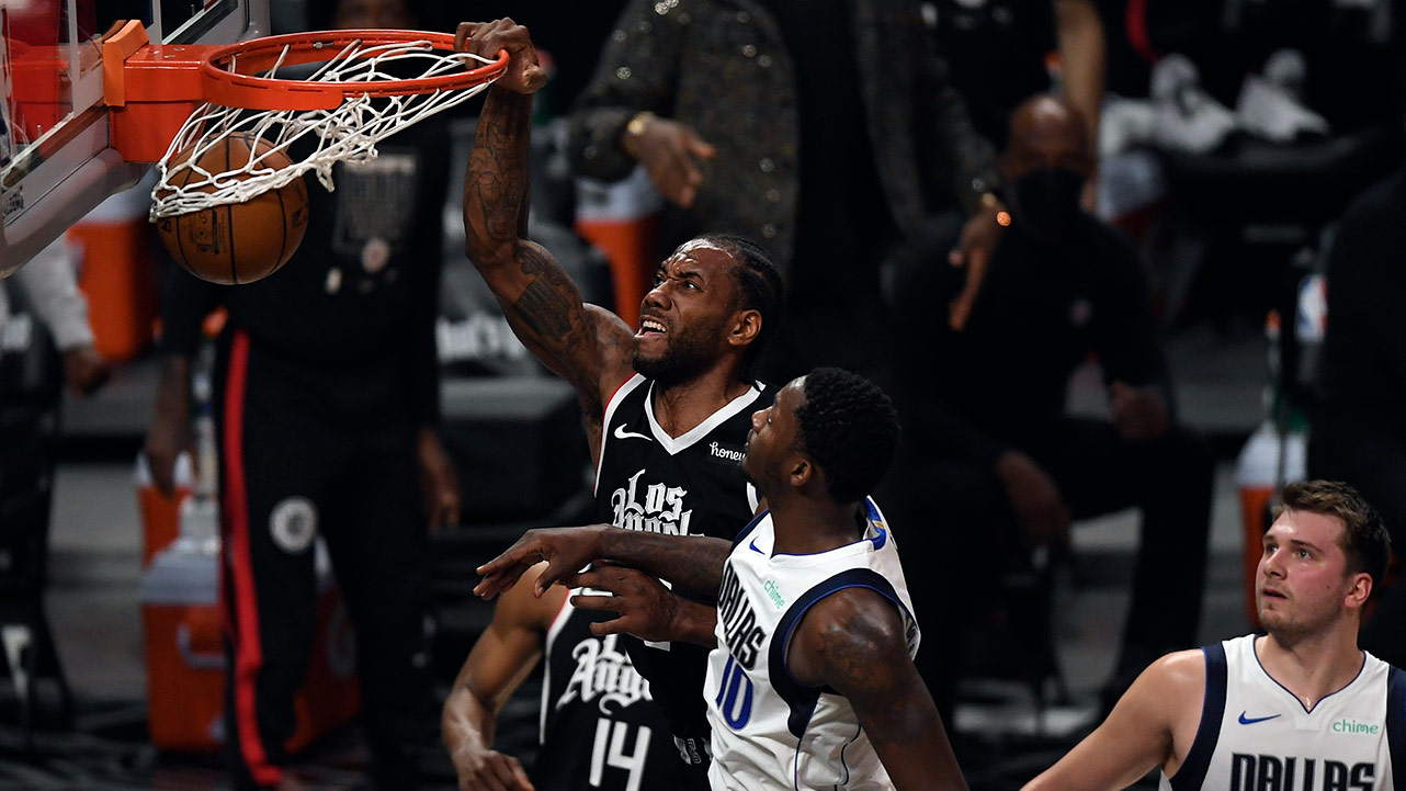 LOS ANGELES, CA - JUNE 06: Kawhi Leonard #2 of the Los Angeles Clippers dunks the ball against Dorian Finney-Smith #10 of the Dallas Mavericks during the first half of Game Seven of the Western Conference first round series at Staples Center on June 6, 2021 in Los Angeles, California.