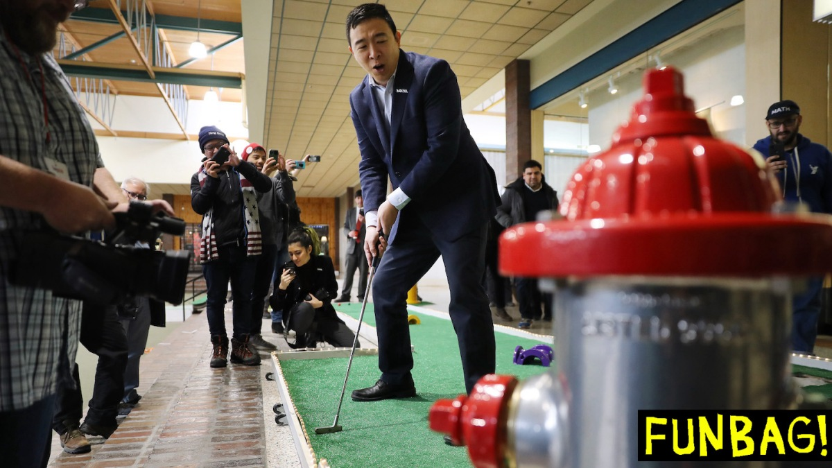 OSKALOOSA, IOWA - JANUARY 25: Democratic presidential candidate Andrew Yang plays mini-golf after holding a town hall meeting at Penn Central Mall January 25, 2020 in Oskaloosa, Iowa. While three of the top-polling Democratic presidential candidates are U.S. Senators and must be in Washington for the impeachment trial of President Donald Trump, millionaire businessman Yang continues to campaign across Iowa ahead of its all-important caucuses scheduled for February 03. (Photo by Chip Somodevilla/Getty Images)