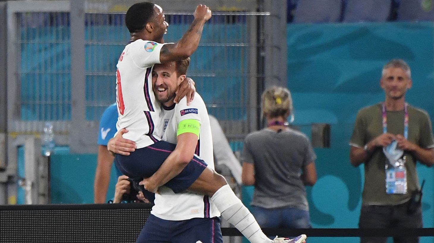 England's forward Harry Kane celebrates with England's forward Raheem Sterling (L) after scoring third goal during the UEFA EURO 2020 quarter-final football match between Ukraine and England at the Olympic Stadium in Rome on July 3, 2021.