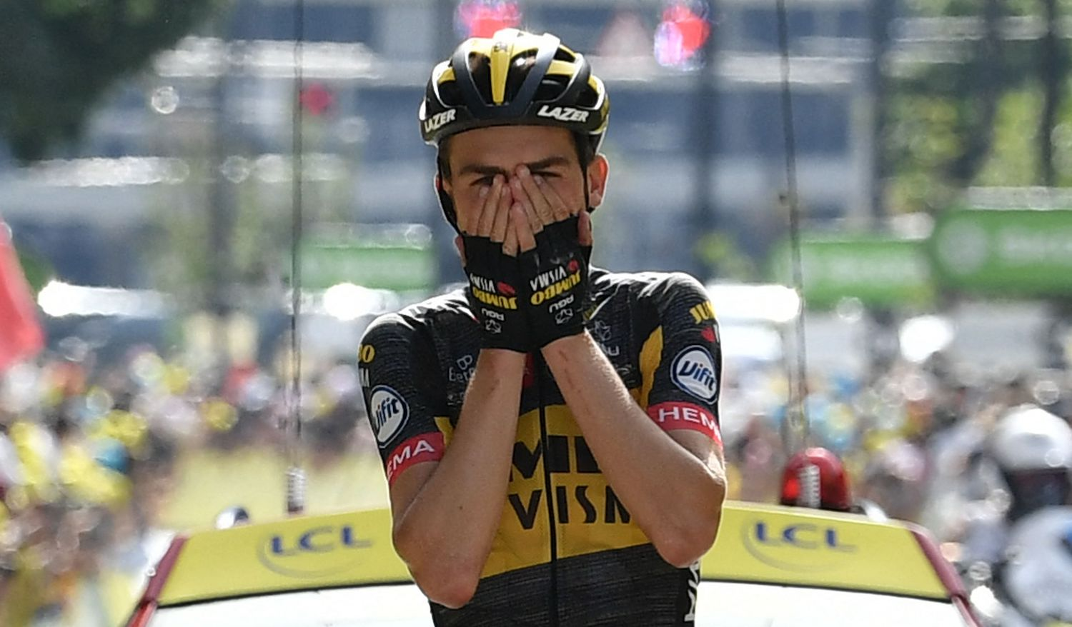 TOPSHOT - Team Jumbo Visma's Sepp Kuss of US celebrates as he crosses the finish line of the 15th stage of the 108th edition of the Tour de France cycling race, 191 km between Ceret and Andorre-La-Vieille, on July 11, 2021. (Photo by Philippe LOPEZ / AFP) (Photo by PHILIPPE LOPEZ/AFP via Getty Images)