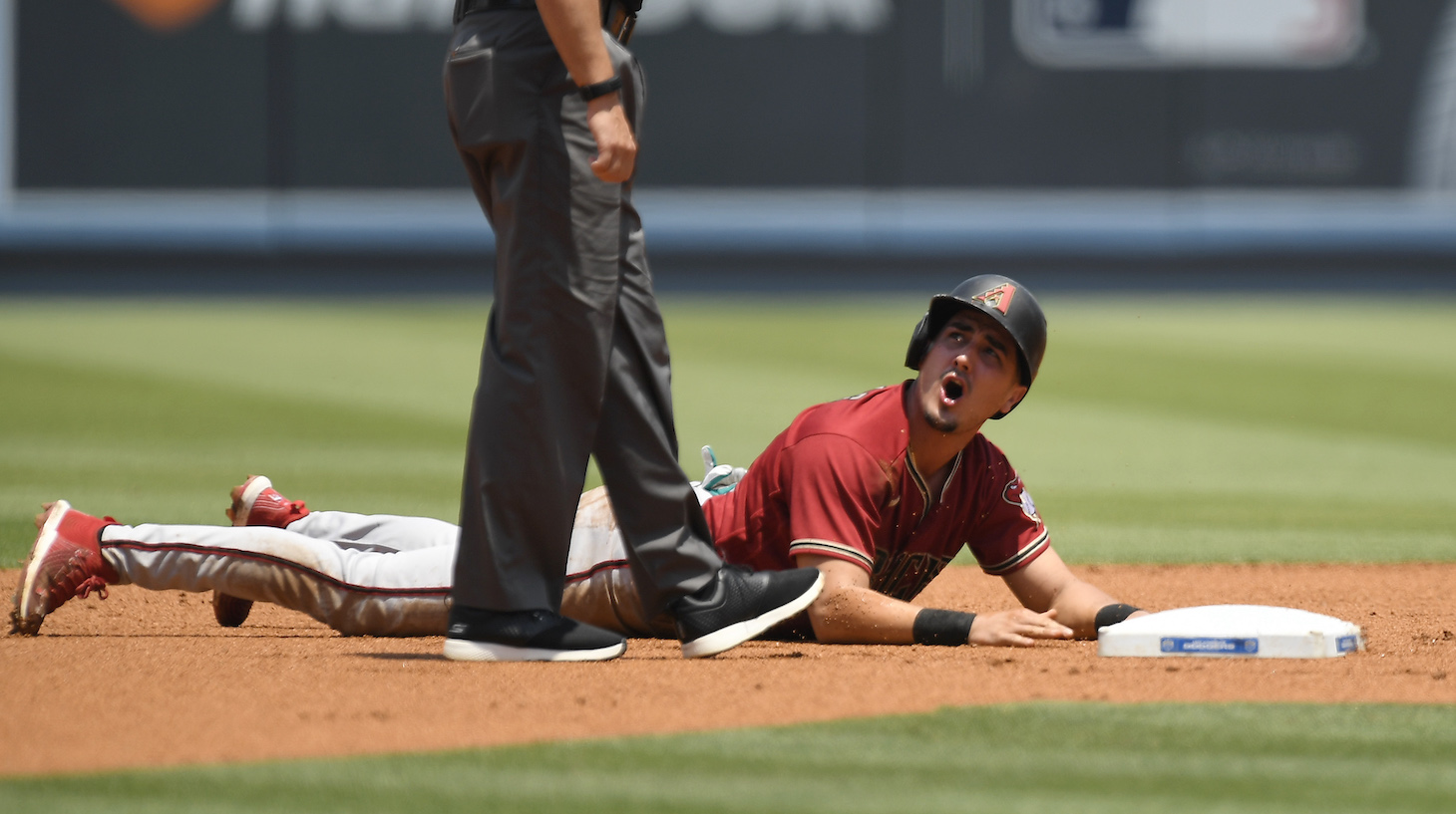 LOS ANGELES, CA - JULY 11: Josh Rojas #10 of the Arizona Diamondbacks reacts to second base umpire Brian O'Nora #7 after he was called out trying to steal second base against the Los Angeles Dodgers during the first inning at Dodger Stadium on July 11, 2021 in Los Angeles, California. (Photo by Kevork Djansezian/Getty Images)