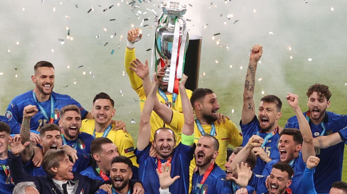 Italy's defender Giorgio Chiellini raises the European Championship trophy during the presentation after Italy won the UEFA EURO 2020 final football match between Italy and England at the Wembley Stadium in London on July 11, 2021.