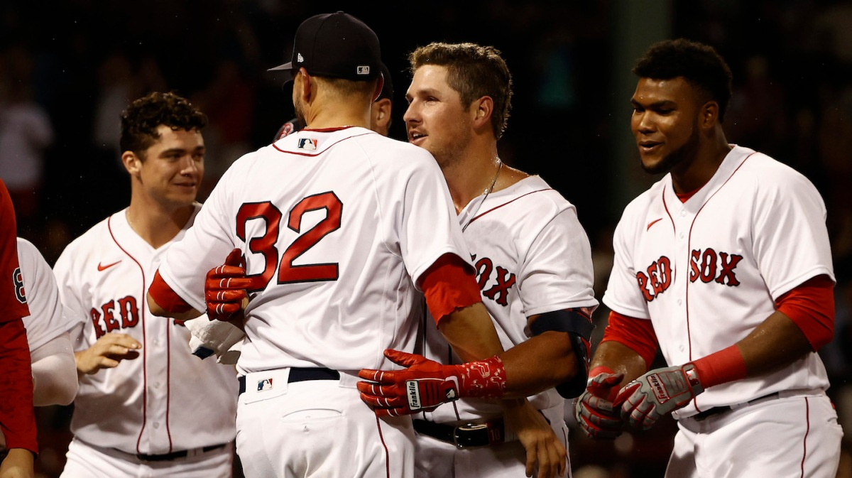 BOSTON, MA - JULY 22: Hunter Renfroe #10 of the Boston Red Sox is congratulated by Matt Barnes #32 after his game-winning sacrifice fly in the 10th inning against the New York Yankees at Fenway Park on July 22, 2021 in Boston, Massachusetts. (Photo By Winslow Townson/Getty Images)