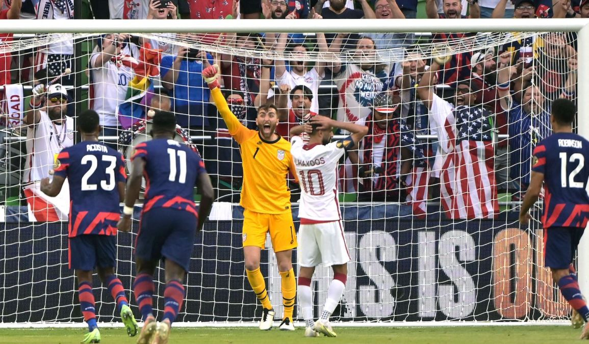 USA's goalkeeper Matt Turner (C) celebrates after Qatar's forward Hasan Al Haydos (2nd R) missed a penalty kick during the Concacaf Gold Cup semifinal football match between Qatar and USA at Q2 stadium in Austin, Texas on July 29, 2021. (Photo by Sergio FLORES / AFP) (Photo by SERGIO FLORES/AFP via Getty Images)