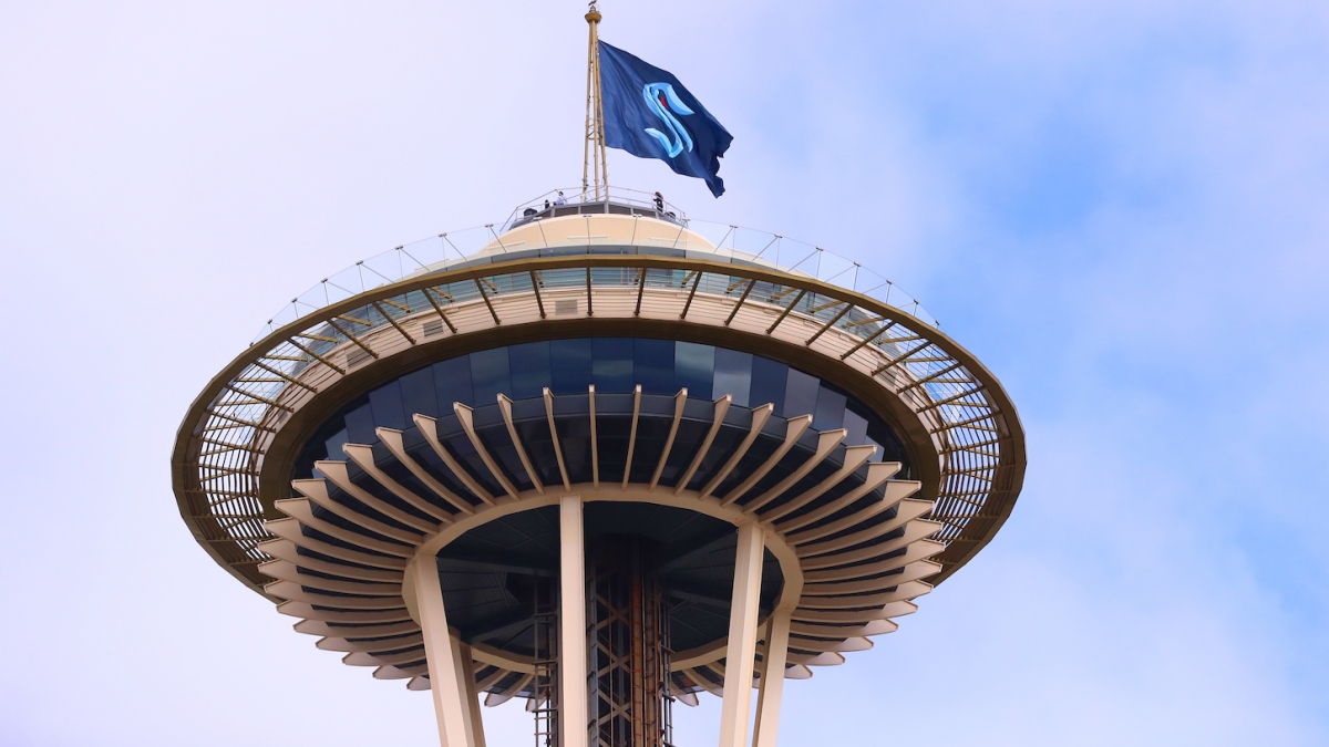 SEATTLE, WASHINGTON - JULY 23: A general view of the Space Needle as the Seattle Kraken team flag is hung from above on July 23, 2020 in Seattle, Washington. The NHL revealed the franchise's new team name today. (Photo by Abbie Parr/Getty Images)