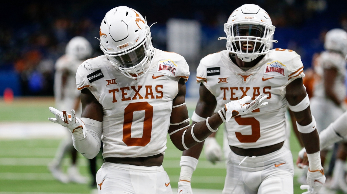 SAN ANTONIO, TEXAS - DECEMBER 29: DeMarvion Overshown #0 and D'Shawn Jamison #5 of the Texas Longhorns react after a turnover in the fourth quarter against the Colorado Buffaloes during the Valero Alamo Bowl at the Alamodome on December 29, 2020 in San Antonio, Texas. (Photo by Tim Warner/Getty Images)