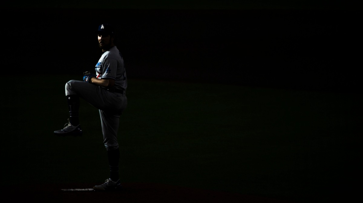 HOUSTON, TEXAS - MAY 26: Trevor Bauer #27 of the Los Angeles Dodgers winds up to pitch during the first inning against the Houston Astros at Minute Maid Park on May 26, 2021 in Houston, Texas. (Photo by Carmen Mandato/Getty Images)