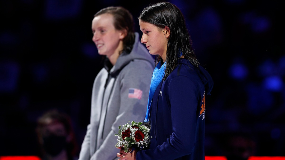 OMAHA, NEBRASKA - JUNE 19: Katie Ledecky and Katie Grimes react during the Women's 800m freestyle medal ceremony during Day Seven of the 2021 U.S. Olympic Team Swimming Trials at CHI Health Center on June 19, 2021 in Omaha, Nebraska. (Photo by Maddie Meyer/Getty Images)