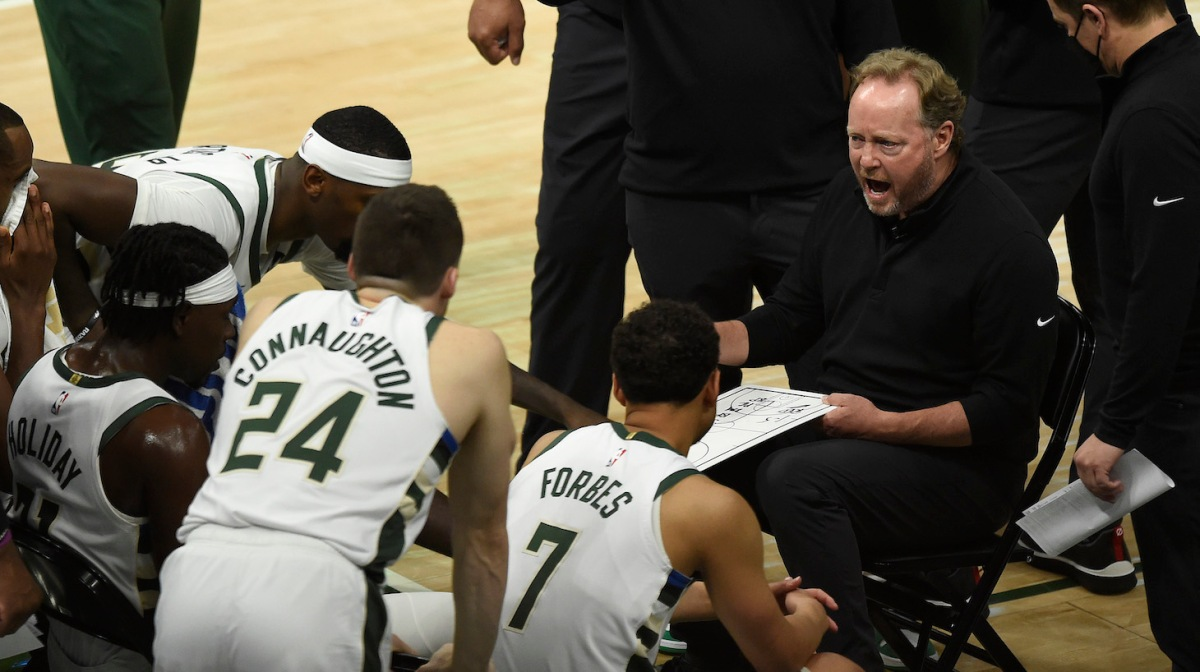 MILWAUKEE, WISCONSIN - JUNE 25: Head coach Mike Budenholzer of the Milwaukee Bucks draws up a play during a huddle during the second half in game two of the Eastern Conference Finals against the Atlanta Hawks at Fiserv Forum on June 25, 2021 in Milwaukee, Wisconsin. NOTE TO USER: User expressly acknowledges and agrees that, by downloading and or using this photograph, User is consenting to the terms and conditions of the Getty Images License Agreement. (Photo by Patrick McDermott/Getty Images)