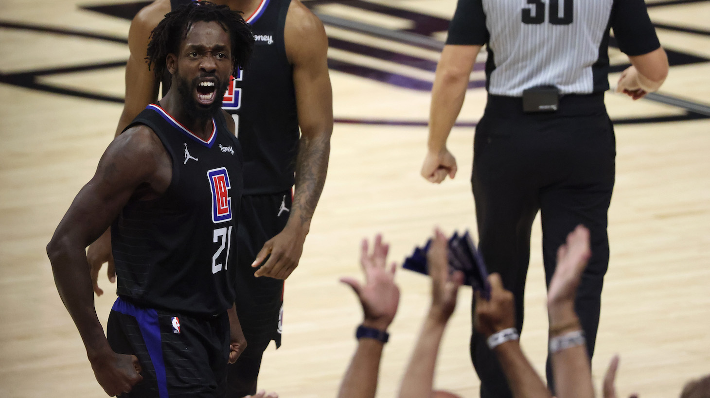 LOS ANGELES, CALIFORNIA - JUNE 30: Patrick Beverley #21 of the LA Clippers reacts to the crowd after a Phoenix Suns foul during the first half in Game Six of the Western Conference Finals at Staples Center on June 30, 2021 in Los Angeles, California. NOTE TO USER: User expressly acknowledges and agrees that, by downloading and or using this photograph, User is consenting to the terms and conditions of the Getty Images License Agreement. (Photo by Harry How/Getty Images)
