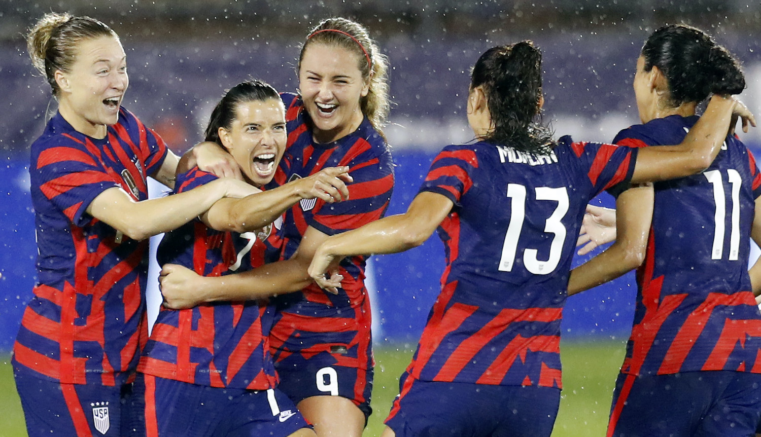 EAST HARTFORD, CONNECTICUT - JULY 01: Tobin Heath #7 of United States celebrates with Christen Press #11, Alex Morgan #13, Lindsey Horan #9 and Emily Sonnett, #14 after scoring a goal against Mexico at Rentschler Field on July 01, 2021 in East Hartford, Connecticut. (Photo by Maddie Meyer/Getty Images)