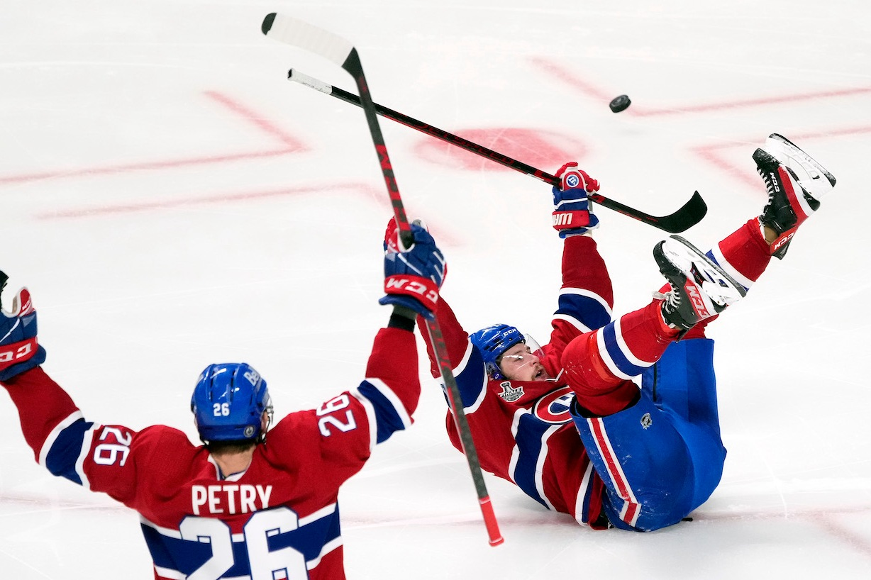 MONTREAL, QUEBEC - JULY 05: Josh Anderson #17 of the Montreal Canadiens celebrates with Jeff Petry #26 after scoring the game-winning goal to give his team the 3-2 win against the Tampa Bay Lightning during the first overtime period in Game Four of the 2021 NHL Stanley Cup Final at the Bell Centre on July 05, 2021 in Montreal, Quebec, Canada. (Photo by Mark Blinch/Getty Images)