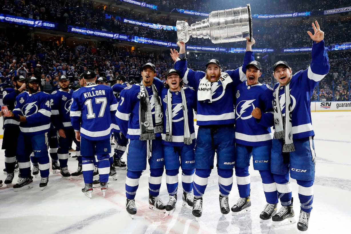 TAMPA, FLORIDA - JULY 07: The Tampa Bay Lightning celebrate after defeating the Montreal Canadiens 1-0 in Game Five to win the 2021 NHL Stanley Cup Final at Amalie Arena on July 07, 2021 in Tampa, Florida. (Photo by Bruce Bennett/Getty Images)