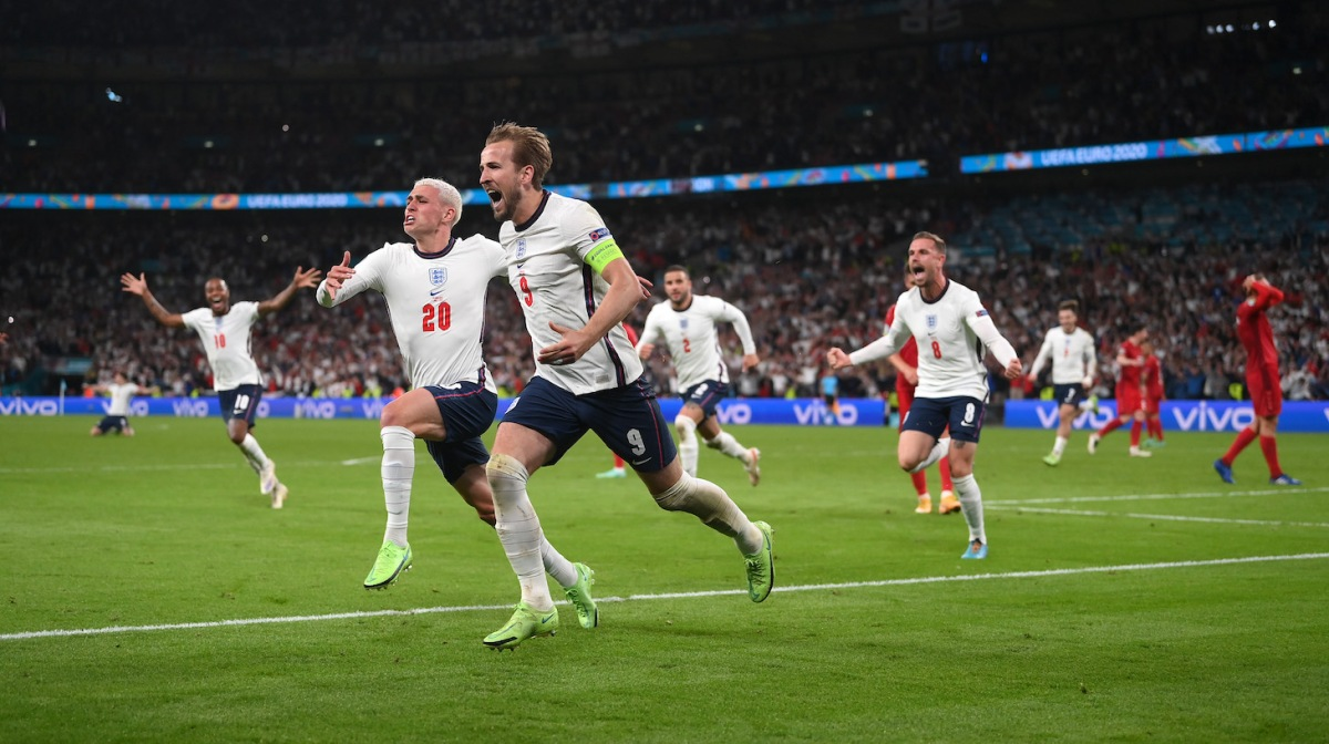 Harry Kane of England is congratulated by Phil Foden after scoring the second goal during the UEFA Euro 2020 Championship Semi-final match between England and Denmark at Wembley Stadium on July 07, 2021 in London, England.