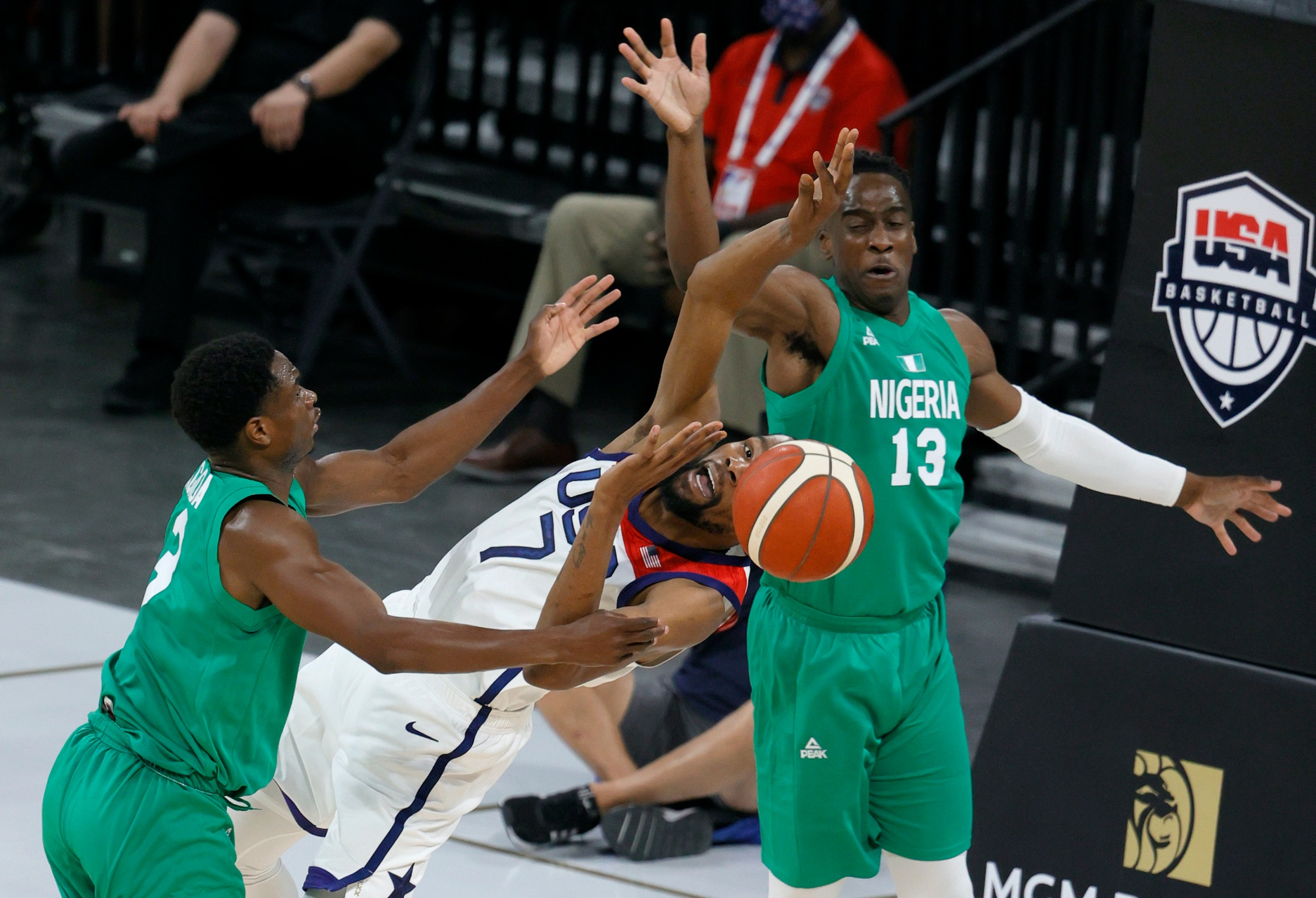 Caleb Agada #3 of Nigeria fouls Kevin Durant #7 of the United States as Miye Oni #13 of Nigeria defends during an exhibition game at Michelob ULTRA Arena ahead of the Tokyo Olympic Games on July 10, 2021 in Las Vegas, Nevada.