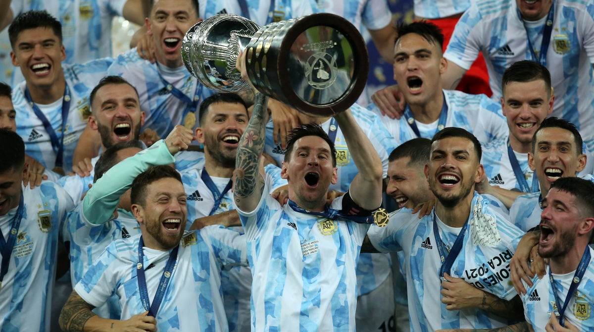 Lionel Messi of Argentina lifts the trophy with teammates after winning the final of Copa America Brazil 2021 between Brazil and Argentina at Maracana Stadium on July 10, 2021 in Rio de Janeiro, Brazil.