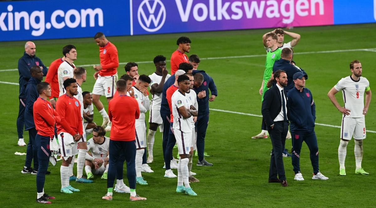 England players look on dejected after losing in the penalty shoot out during the UEFA Euro 2020 Championship Final between Italy and England at Wembley Stadium on July 11, 2021 in London, England.