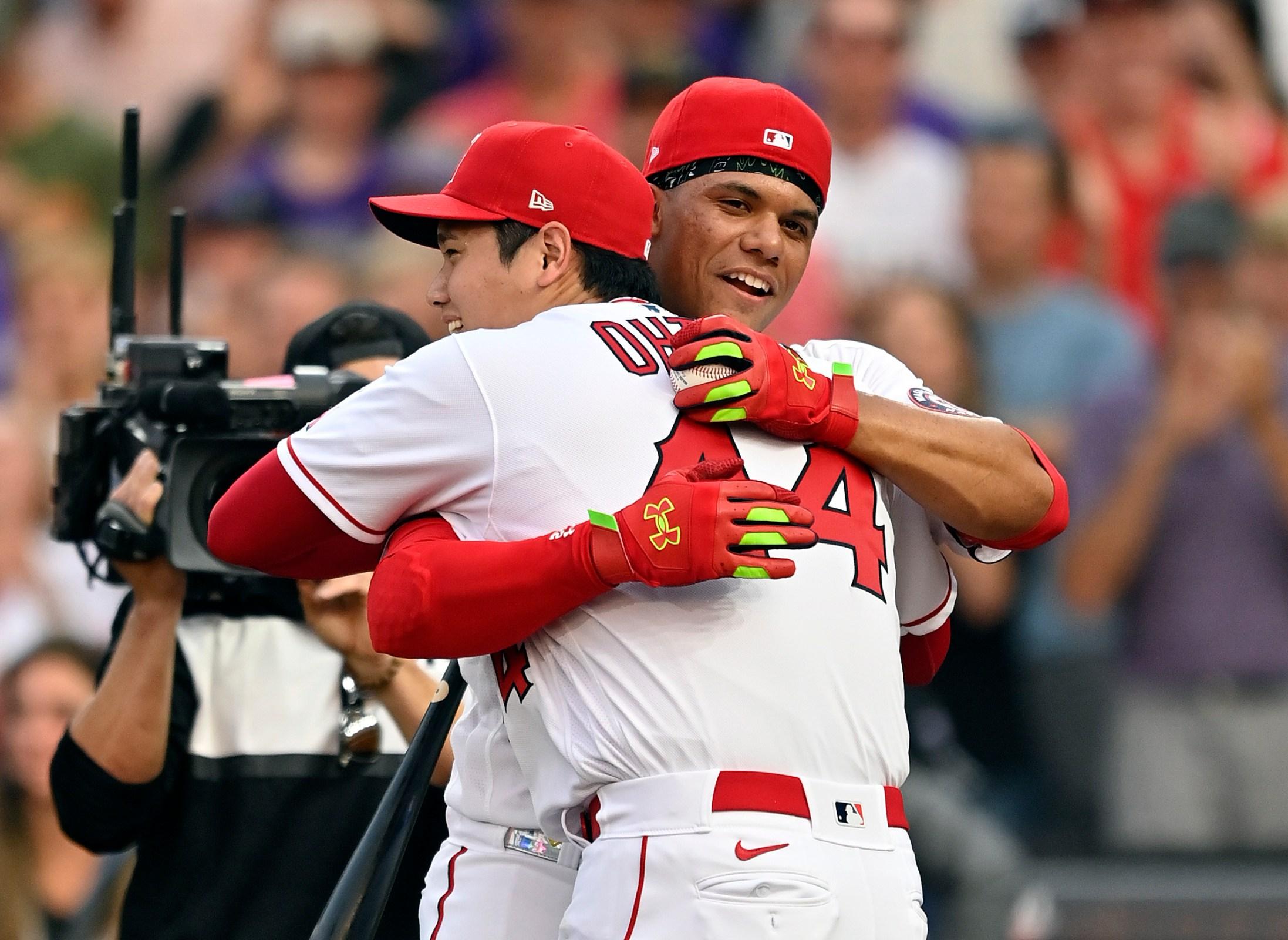 Juan Soto hugs Shohei Ohtani