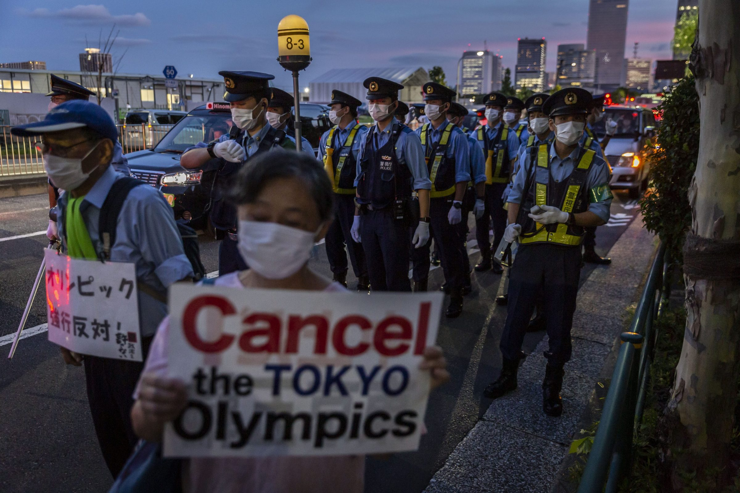 Police officers and protestors at a July protest against the Tokyo Olympics.