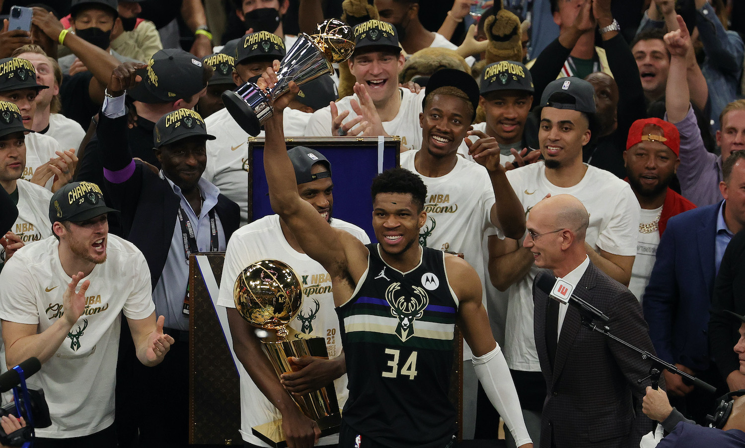 MILWAUKEE, WISCONSIN - JULY 20: Giannis Antetokounmpo #34 of the Milwaukee Bucks celebrates winning the Bill Russell NBA Finals MVP Award after defeating the Phoenix Suns in Game Six to win the 2021 NBA Finals at Fiserv Forum on July 20, 2021 in Milwaukee, Wisconsin. NOTE TO USER: User expressly acknowledges and agrees that, by downloading and or using this photograph, User is consenting to the terms and conditions of the Getty Images License Agreement. (Photo by Jonathan Daniel/Getty Images)