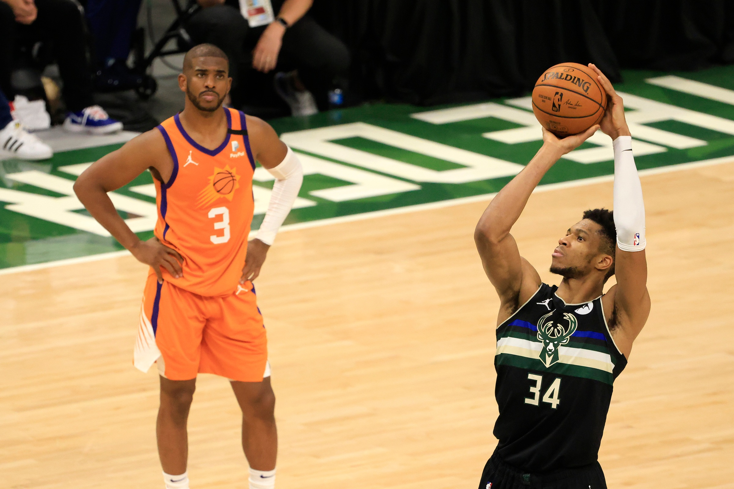 MILWAUKEE, WISCONSIN - JULY 20: Giannis Antetokounmpo #34 of the Milwaukee Bucks shoots a free throw as Chris Paul #3 of the Phoenix Suns watches during the second half in Game Six of the NBA Finals at Fiserv Forum on July 20, 2021 in Milwaukee, Wisconsin. NOTE TO USER: User expressly acknowledges and agrees that, by downloading and or using this photograph, User is consenting to the terms and conditions of the Getty Images License Agreement.