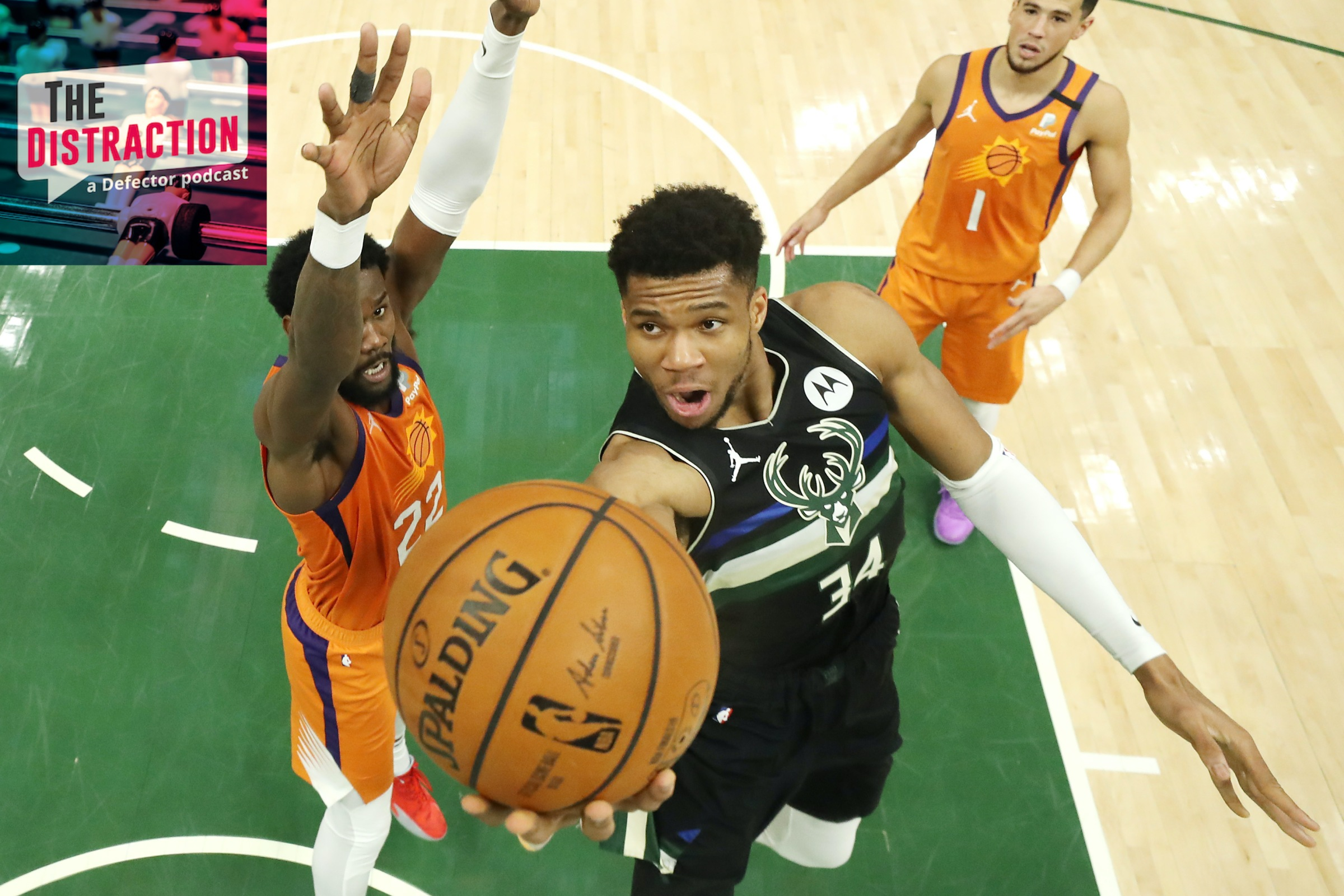 Giannis Antetokounmpo driving for one of his many baskets in the decisive Game 6 of the NBA Finals.