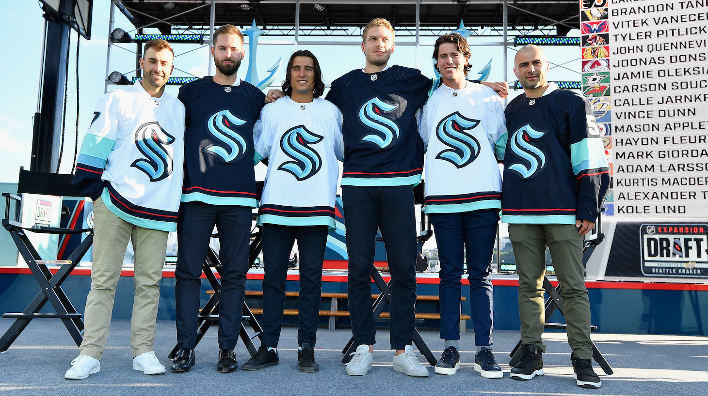 SEATTLE, WASHINGTON - JULY 21: The Seattle Kracken draft picks (L-R) Jordan Eberle, Chris Driedger, Chris Tanev, Jamie Oleksiak, Haydn Fleury and Mark Giordano following the 2021 NHL Expansion Draft at Gas Works Park on July 21, 2021 in Seattle, Washington. The Seattle Kraken is the National Hockey League's newest franchise and will begin play in October 2021. (Photo by Alika Jenner/Getty Images)