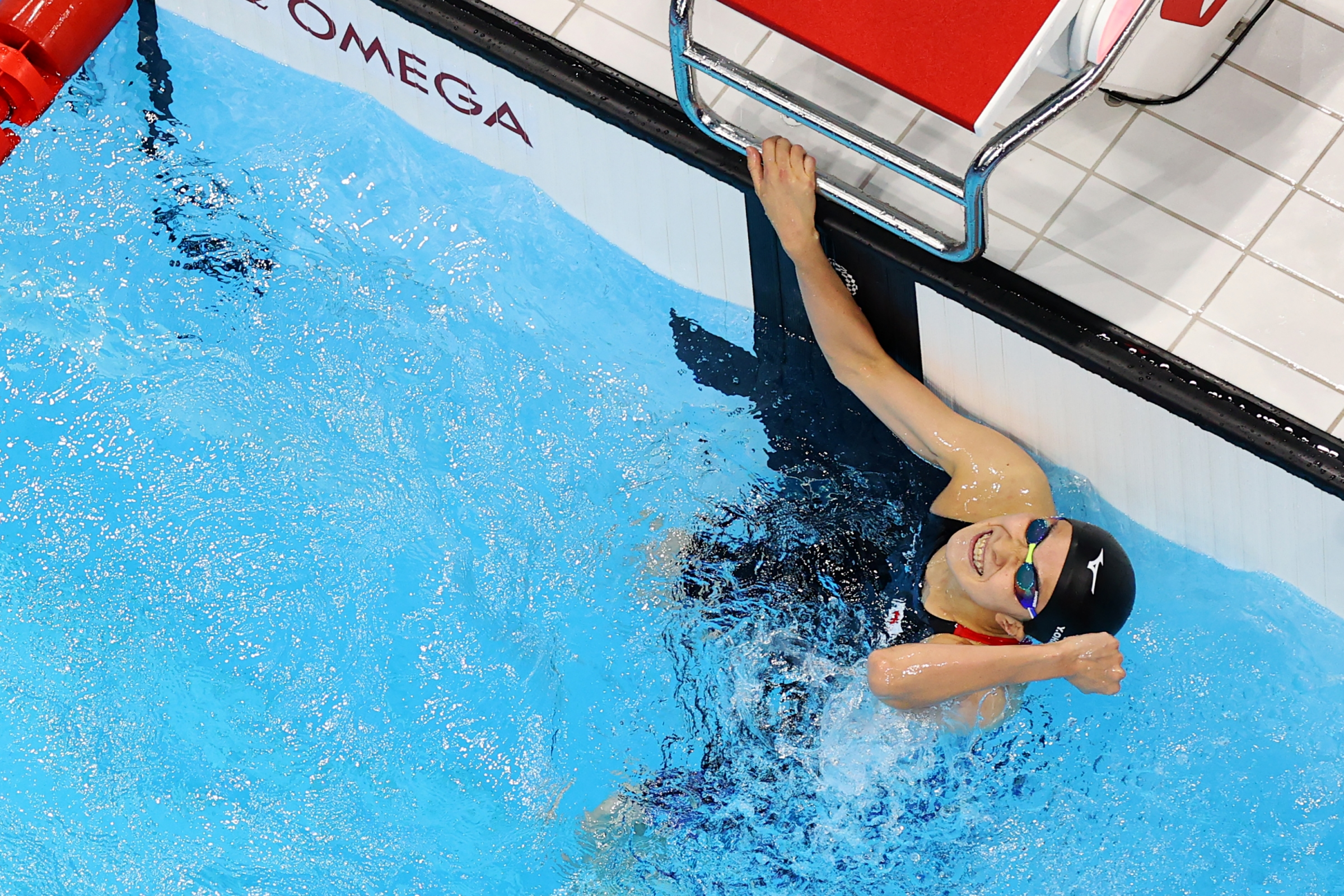 Yui Ohashi of Team Japan celebrates after winning the Women's 200m Individual Medley Final on day five of the Tokyo 2020 Olympic Games at Tokyo Aquatics Centre on July 28, 2021 in Tokyo, Japan.