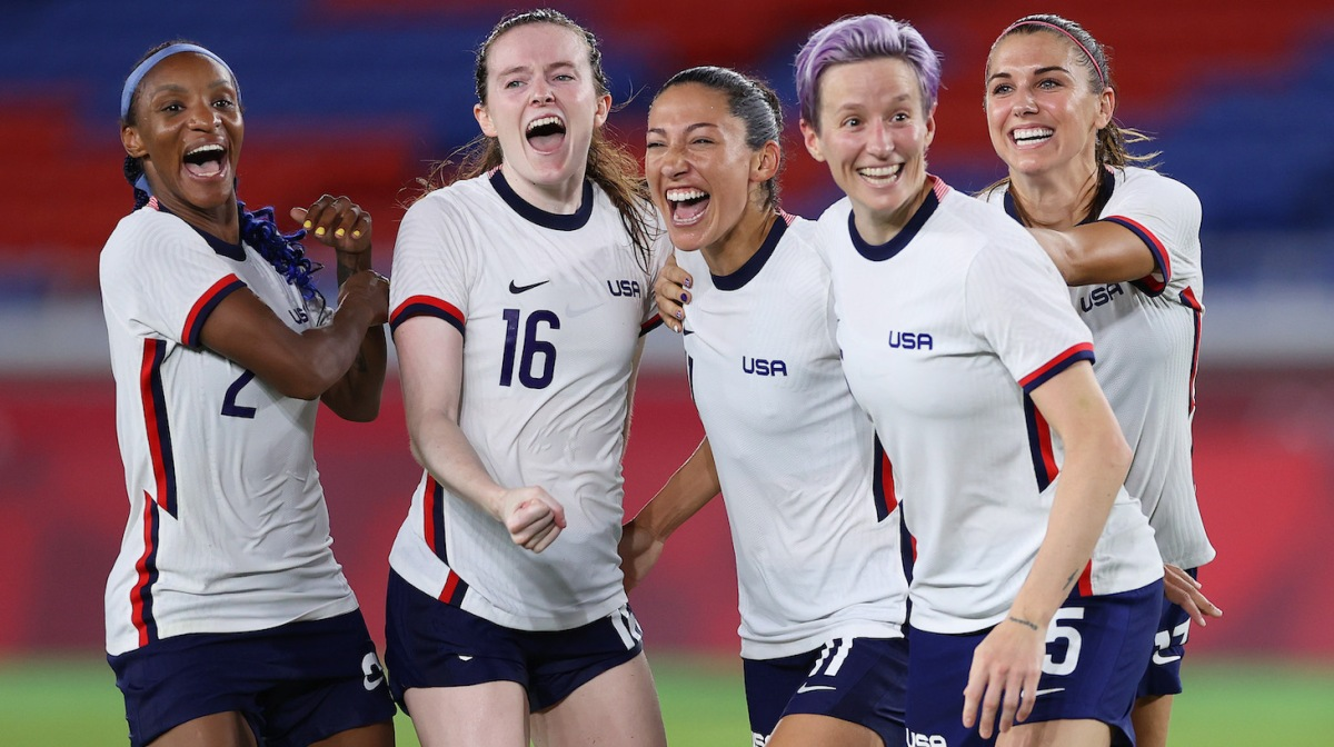 Crystal Dunn #2, Rose Lavelle #16, Christen Press #11, Megan Rapinoe #15 and Alex Morgan #13 of Team United States celebrate following their team's victory in the penalty shoot out after the Women's Quarter Final match between Netherlands and United States on day seven of the Tokyo 2020 Olympic Games at International Stadium Yokohama on July 30, 2021 in Yokohama, Kanagawa, Japan.